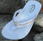 Whiite flat flip flops with fabric straps lined with rhinestones for wedding