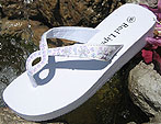 White bridal flip flops with irridescent sequins and unique twist for your wedding.