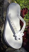 white bridal flip flops with satin flower and pearls